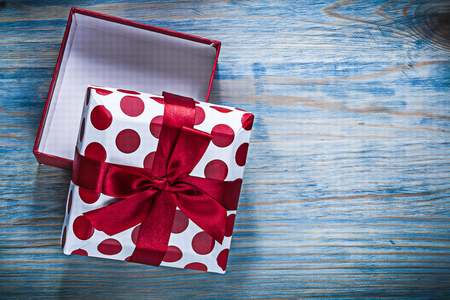 Red opened gift box on wooden board holidays concept. Stock Photo