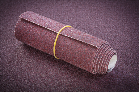 emery paper: Rolled emery paper on polishing sheet abrasive materials. Stock Photo