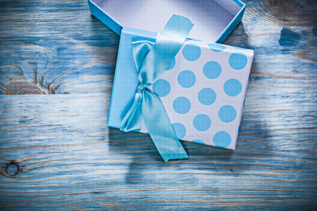 Opened blue present box on wooden board holidays concept. Stock Photo