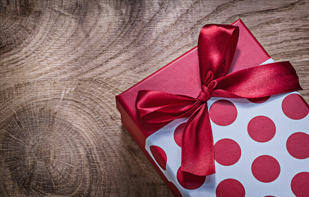 Red packed gift box on wooden board celebrations concept.