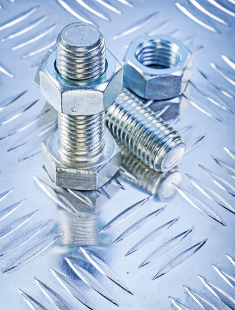 channeled: Stainless bolt details and construction nuts on channeled metal sheet maintenance concept.