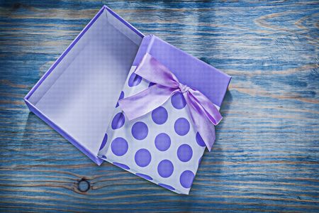 Wrapped gift box on wooden board holidays concept.