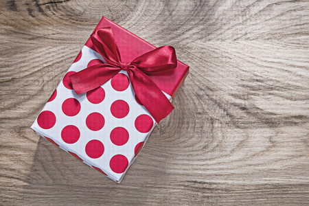 Red gift box on wooden board celebrations concept. Stock Photo