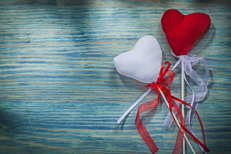 heartshaped: Composition of red and white Valentine hearts with ribbons on wooden board celebrations concept.