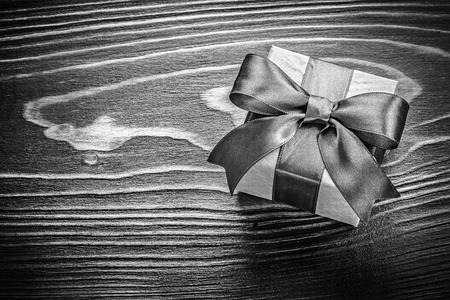 Gift box on wooden board holidays concept.