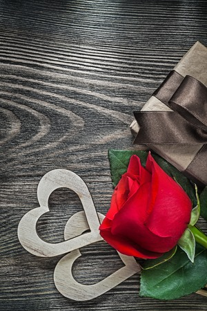 heartshaped: Wooden hearts red rose present box on wood board holidays concept.