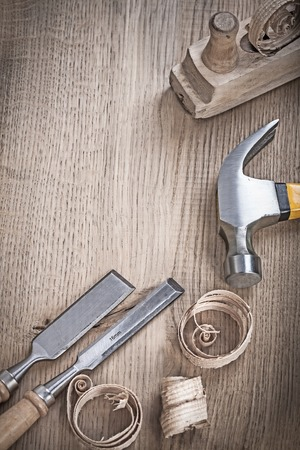 close up view on hammer chisels and planner shavings.