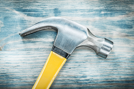 Claw hammer on wooden board construction concept. Stock Photo