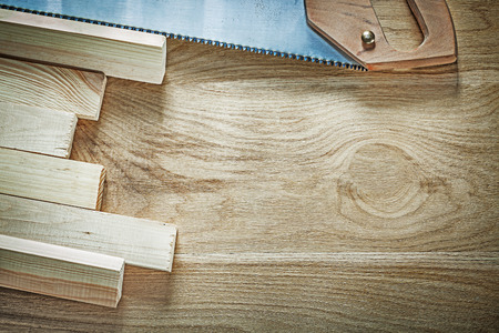 Composition of handsaw wooden planks on wood board construction concept. Stock Photo