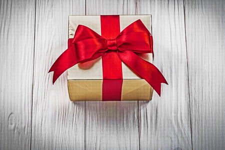 yuletide: Gift box on wood board top view holidays concept. Stock Photo