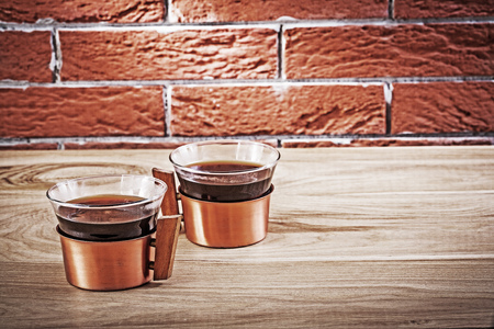 two copper coffe cups in vintage interior.