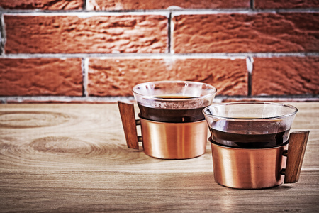 close up cooffee in vintage copper cups on table.