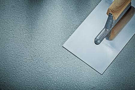 Stainless plastering trowel on concrete background construction concept. Stock fotó - 81413403