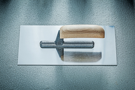 palette knife: Stainless bricklaying trowel on concrete background construction concept.