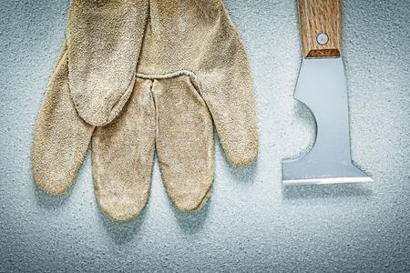 palette knife: Construction spatula safety gloves on concrete surface building concept.