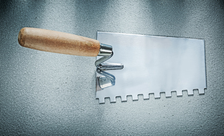Bricklaying trowel on concrete background construction concept. Фото со стока
