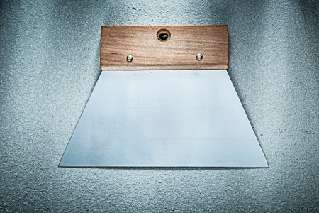palette knife: Bricklaying trowel on concrete surface directly above construction concept.