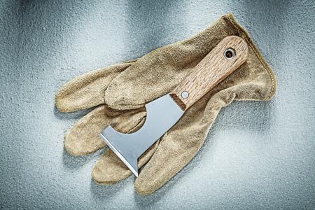 palette knife: Plastering trowel safety gloves on concrete surface construction concept.