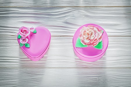 Pink metal gift boxes on wooden board celebrations concept.
