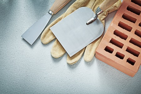 palette knife: Construction brick leather protective gloves putty knives on concrete surface bricklaying concept.