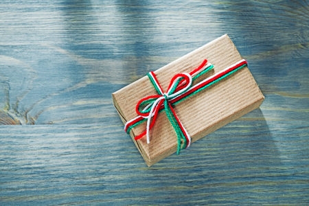 Christmas gift box on wooden board celebrations concept.