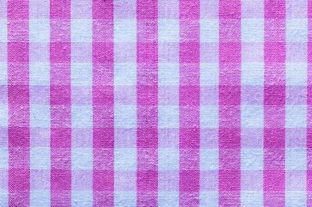 Pink checked cotton fabric horizontal image.