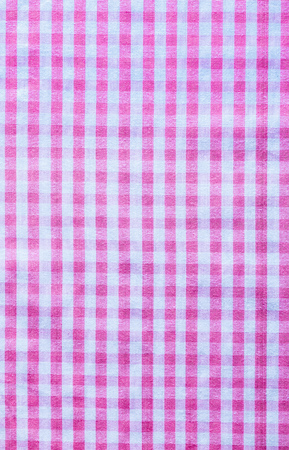 Pink checked cotton background close up view.