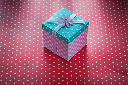 Present box on red polka-dot table cloth celebrations concept. Stok Fotoğraf