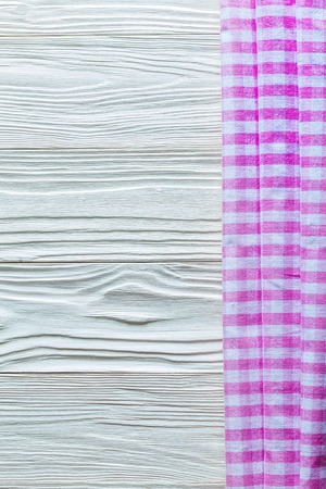 Pink white cotton table cloth on wooden board. Stock Photo