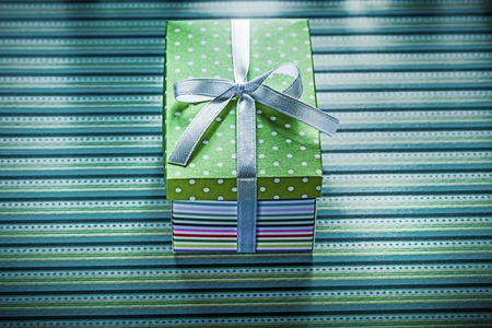 Present box on striped background holidays concept. Stock Photo
