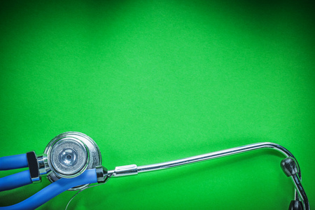 Medical auscultator for checkup on green background. Stock Photo