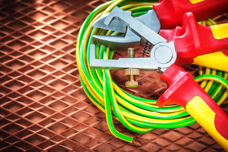 Insulation strippers electric cable on dielectric mat. Stock Photo