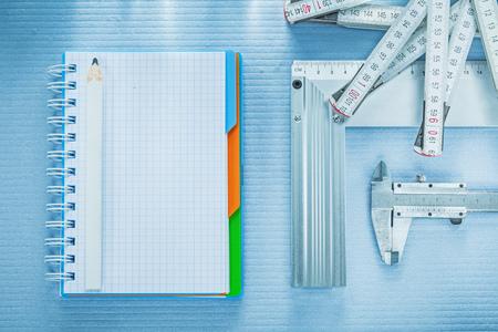 Square ruler vernier caliper notepad pencil tape measure.