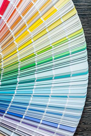 Color sampler fan on wooden board. Stock Photo