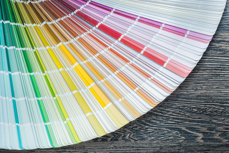 Color pantone fan on wooden board top view. Stock Photo