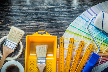 Paint brushes roller tray color pantone fan adhesive tape wood meter. Stock Photo