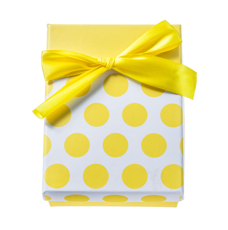 Yellow wrapped present box isolated on white.