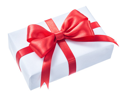 White wrapped present box with red ribbon isolated on white. Stock Photo