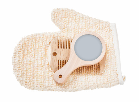 Wooden mirror comb fluffy washcloth isolated on white.