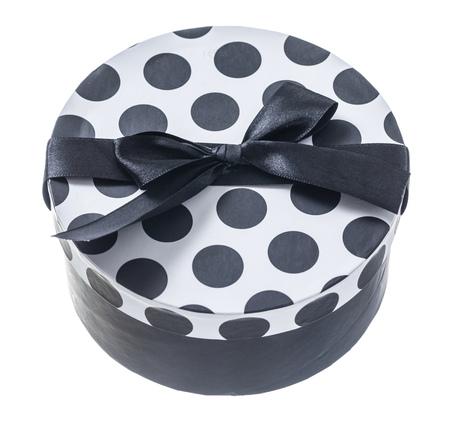 Round black gift box isolated on white.