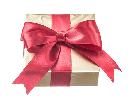 Gift wrapped in glittery paper with red ribbon isolated on white.