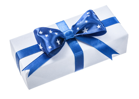 Wrapped white gift box with blue ribbon isolated on white.