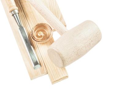 Wooden mallet bricks flat chisel shavings isolated on white.