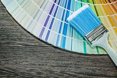 Paintbrush color sampler on wood board.