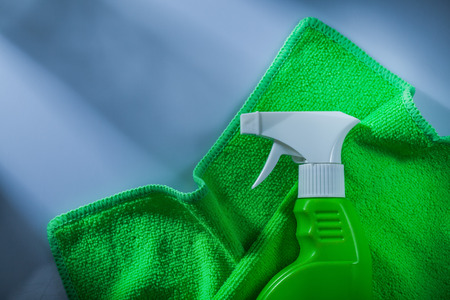 Plastic sprayer cleaning cloth on white background.