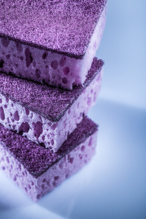 New violet washing sponges on white surface. Stock Photo