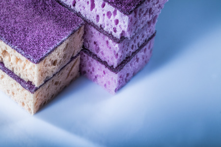 Pile of kitchen sponges on white surface. Stock Photo