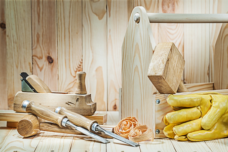 set of carpenter tools with wooden toolbox on wood background Archivio Fotografico