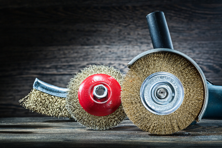 angle grinder with set of abrasive wire brushes