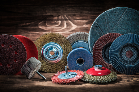 abrasive rotary wheels set on vintage wood